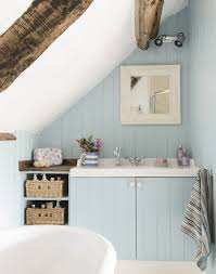 exposed beams rattan baskets and a blue colour palette give this