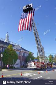 Country American Flag A Large American Flag Hangs From An Extension Ladder Of A Fire