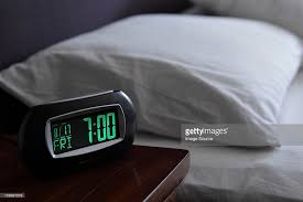 alarm clock by bed stock photo getty images