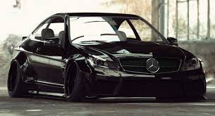 mercedes c63amg liberty walk puts a jdm touch on mercedes c63 amg coupe