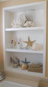 seashell bathroom decor ideas sea shells the built in beadboard shelves coastal