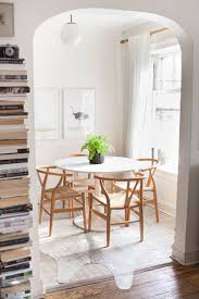 what shape of small dining tables should you pick hupehome source stella harasek alaina kaczmarski s lincoln park apartment dining area