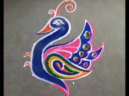 dotted peacock rangoli with butterfly kolam designs