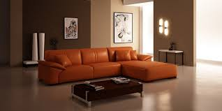 living room cream upholstered sectional sofa with orange cushion