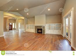 living room with vaulted ceiling spacious empty living room interior with vaulted ceiling stock