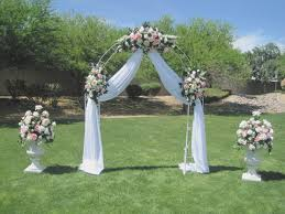 wedding arches using tulle how to decorate a wedding arch with tulle and flowers archives