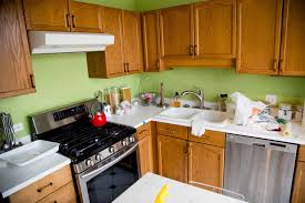 painting wood kitchen cabinets how to paint wood kitchen cabinets girl nesting