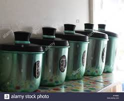 set of anodised coloured antique kitchen canisters stock photo