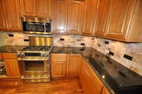 wonderful backsplash with uba tuba granite on small home remodel