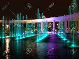 water fountain with lights water fountain with colourful light reflection at water surface