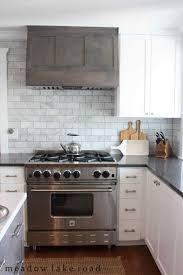 kitchen with subway tile backsplash a herringbone pattern simply swider back kitchen subway tile