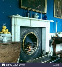 fireplace with lit fire in blue livingroom stock photo royalty