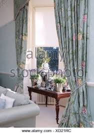 Blue And White Floral Curtains Pots Of Lavender On Table In Window With Pale Blue Floral Curtains