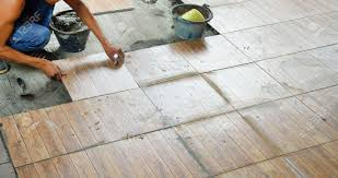 construction worker tiling the floor stock photo picture and