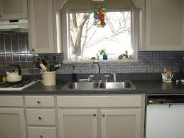 kitchen design with white kitchen cabinet and tin backsplash also
