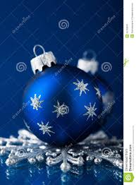 silver and blue christmas ornaments on dark blue background with