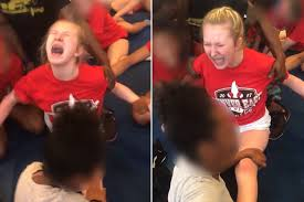 cheerleading squad from hell busted for forcing team into painful