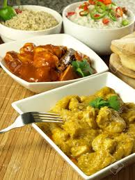 types of indian cuisine two types of indian curry dish with rice and naan stock photo