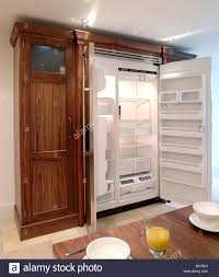 free standing fridge freezer enclosure with storage and finished