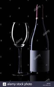 wine silhouette wine bottle and empty glass silhouette on black background stock