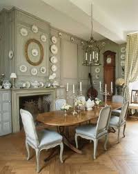 French Country Cushions This Deep Gray Dining Room Blends Country And Traditional Styles
