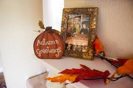 fall home decor michelle got married i laid out some leaf garland and snagged that adorable autumn greetings wood pumpkin for under 3 at hobby lobby