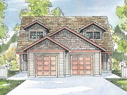 duplex plans with garage in middle tiered gables top the single car garages of this two story multi