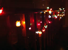 bedroom hanging twinkle lights with green string lights also led