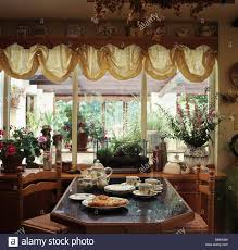 table set for tea in cottage dining room with ruched cream voile