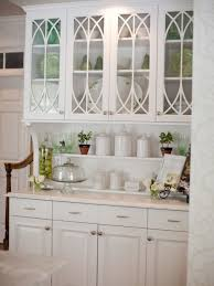 white wooden floating cabinet with glass doors and curving
