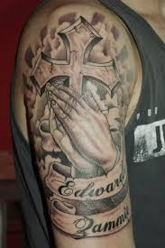 black and grey cross in praying with on half