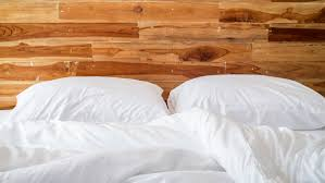 Bed With A Lot Of Pillows How Often You Should Wash Your Sheets U2014 And The Right Way To Do It