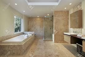 Modern Master Bathroom by Modern Master Bath With Marble Walls And Glass Shower Stock Photo