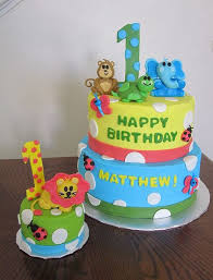 two tier safari theme first birthday cake with animals and