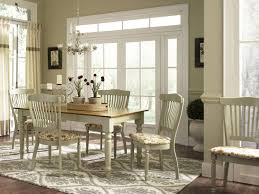warm anc cozy farmhouse dining room with branches chandelier and