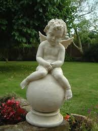 cherub sleeping on garden statues