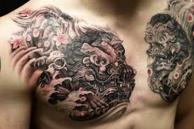 superb black and grey colored foo dogs ripped skin tattoo on chest