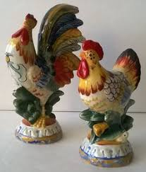 olfaire majolica strawberry salt pepper shakers resting in leaf