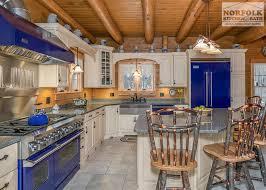 blue kitchen cabinets in cabin log cabin kitchen with blue appliances norfolk kitchen bath