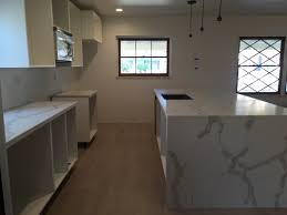 Ready Made Cabinets For Kitchen Calacatta Gold Quartz Countertop Mitered Edeg And Island With