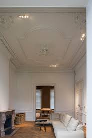 white interior with classic mouldings by schuller restauratie