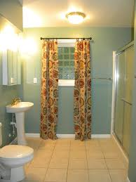 Basement Window Curtains - long light brown curtains with red yellow also green circles