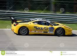 Ferrari 458 Yellow - yellow ferrari 458 challenge evo in action editorial stock image
