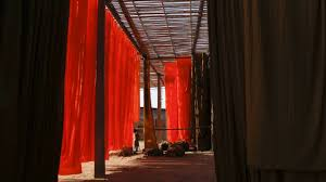 timelapse of newly dyed sari fabric being hung up to dry in a sari