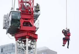 woman rescued from crane faces six criminal mischief charges
