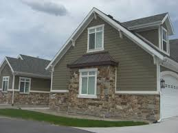 harvest wheat board and batten siding with almond trim siding