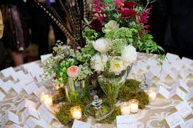 pheasant feather and moss woodsy wedding centerpiece elizabeth