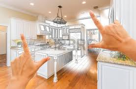 female hands framing gradated custom kitchen design drawing and