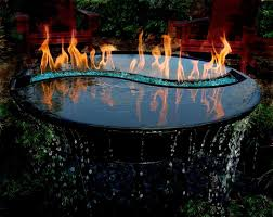 Fire Pit With Water Feature - this is called yin yang it is a water feature and a fire pit in