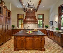 arched kitchen cabinets with copper range hood kitchen traditional